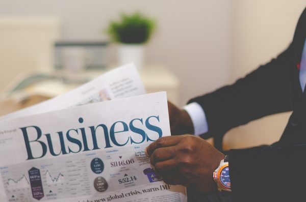 Business articles in newspaper